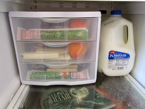 Easy Ways to Organize Your Refrigerator- Tired of constantly digging through your fridge trying to find what you want? You should try these 8 clever refrigerator organizing hacks! | DIY home organization, organize your home, kitchen organization, how to organize your fridge, #organizing #organization #organize #homeOrganization #kitchen #refrigerator #organizingTips #ACultivatedNest