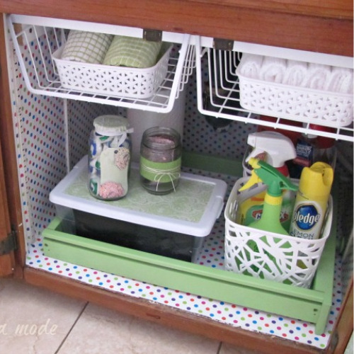 Organizing the Area Under Your Kitchen Sink- Tired of it being messy and disorganized underneath your kitchen sink? Then you need to check out these 8 genius under-sink organizing hacks! | kitchen organizing ideas, #organization #organizingTips #kitchenOrganization #homeOrganization #ACultivatedNest