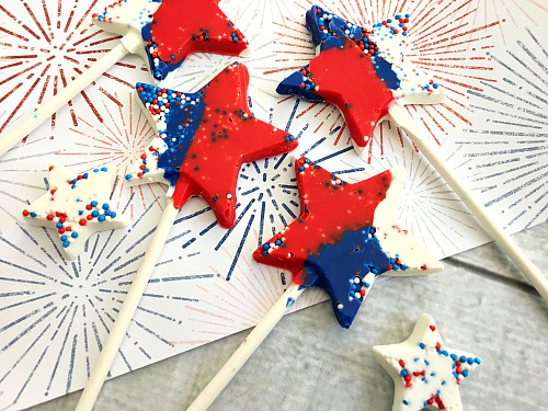 Chocolate Star Pops- These chocolate star pops are a colorful, fun, and easy to make dessert treat that's perfect for holidays and special celebrations! | recipe, food, candy, patriotic, red, white, and blue, Memorial Day, Fourth of July, easy, quick, no-bake, candy melts