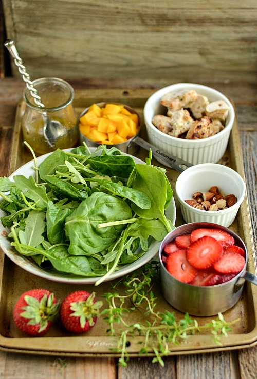 Strawberry Mango Grilled Chicken Salad- A delicious way to use up extra grilled chicken from your last barbecue is to make this strawberry mango grilled chicken salad!   healthy, ways to use rotisserie chicken, easy, summer salad, quick, lunch, dinner, fresh fruit