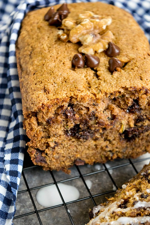 Chocolate Chip Zucchini Bread- If you need to use up some extra zucchinis, or want a clever (and tasty!) way to get your kids to eat some veggies, make this chocolate chip zucchini bread! | baking, dessert bread, vegetables, homemade, recipe, food, bread with glaze, bread with icing on top
