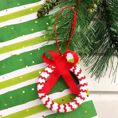 Candy Cane Mason Jar Lid Ornament- Make your Christmas tree even prettier this year with a DIY ornament! Check out my tutorial on how to make a cute candy cane Mason jar lid ornament! #Christmas #diy #craft #ornament