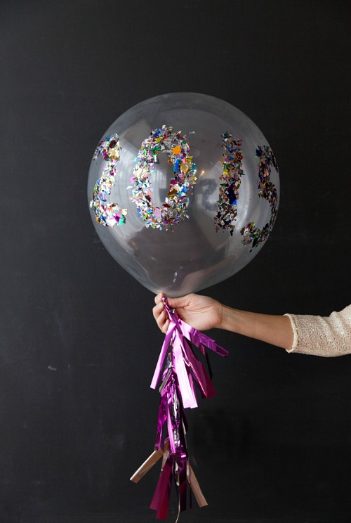 DIY New Year's Eve Balloon- You can have a fun and glamorous New Year's Eve without spending a lot! Check out these 15 DIY New Year's Eve décor ideas for inspiration! #DIY #NewYearsEve #decor #craft #ACultivatedNest