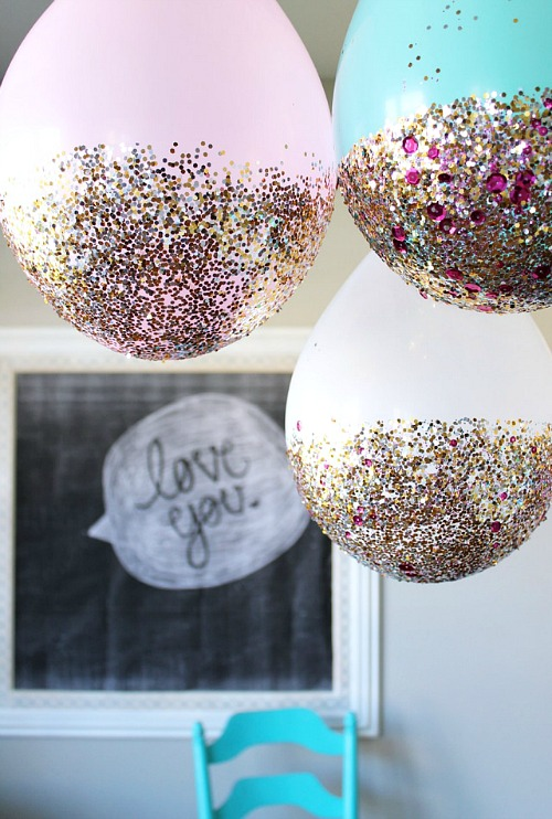 DIY New Year's Eve Glitter Dipped Balloons- You can have a fun and glamorous New Year's Eve without spending a lot! Check out these 15 DIY New Year's Eve décor ideas for inspiration! #DIY #NewYearsEve #decor #craft #ACultivatedNest