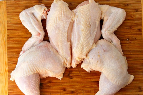 How to Quarter a Whole Chicken- You can save a lot of money on meat if you know how to quarter a whole chicken at home. And it only takes 5 minutes! Check out my easy tutorial! #frugalLiving #chicken #meat #saveMoney