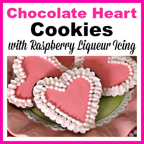 Chocolate Heart Cookies with Raspberry Liqueur Icing- Show your love this Valentine's Day by giving your sweetheart a plate of crunchy chocolate heart cookies with raspberry liqueur icing! Instructions are included for how to make the icing non-alcoholic and kid-friendly. | baking, homemade, dessert, fancy icing, love, alcohol, #cookies #ValentinesDay #heart #recipe