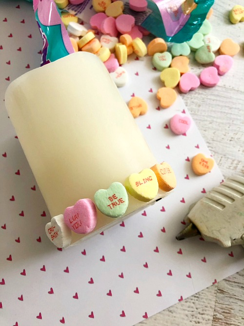 DIY Conversation Heart Valentine's Day Candle- Want a cute, yet inexpensive piece of Valentine's decor? Then you have to make this DIY conversation heart Valentine's Day candle! It's very easy to put together, and can be customized in many fun ways! | Valentine's craft, love, conversation heart candy, sweethearts, craft using food, hearts, #ValentinesDay #candle #diy #Valentines