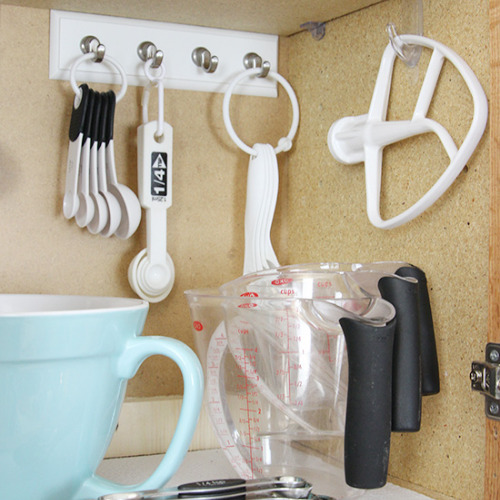 10 Frugal Ways to Organize a Small Kitchen- Organizing your small kitchen will be a lot easier when you know these 10 small kitchen organizing hacks! There are so many clever ways to create storage space in a small kitchen!   how to organize a small space, organize an apartment kitchen, organize a tiny kitchen, #kitchenOrganization #organize #homeOrganization #organizingHacks #ACultivatedNest