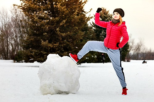 Get Out of Debt By Using The Debt Snowball Method - Woman conquering snowball. | budgeting, how to get out of debt, paying off bills #debt #debtFree #payOffDebt #getOutOfDebt #debtPayoff #payDownDebt #bills #debtSnowball #daveRamsey