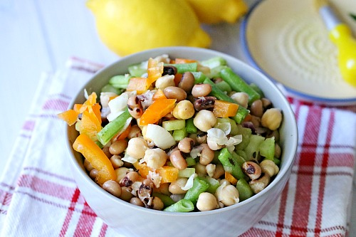 Tangy Chickpea Salad- Looking for an easy and healthy side dish? This tangy chickpea salad is both of those things, plus it's delicious! It makes a great BBQ side dish, too!