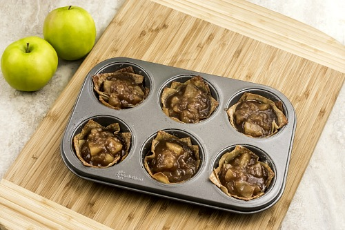 Mini Apple Pie Wonton Cups Autumn Dessert- If you're looking for the perfect fall dessert, you have to make these mini apple pie wonton cups! They're easy to make, and taste so delicious! They'd also make a great party appetizer! | what to make with extra wonton wrappers, use up extra wonton wrappers, #dessert #recipe #baking #applePie #appetizer #food #fall #autumn #apples #wontonWrappers #ACultivatedNest