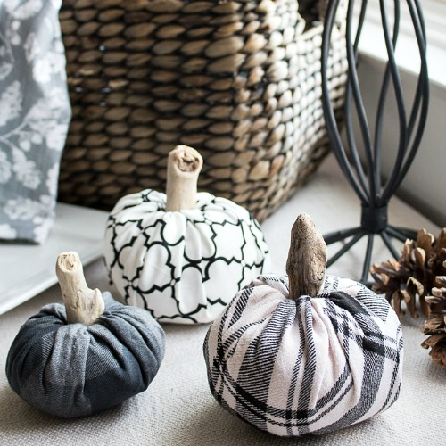 DIY Handmade Cloth Pumpkins (No Sewing Required!)- These no-sew DIY fabric pumpkins are an easy and frugal way to add new fall decor to your home. Plus, they're really easy to customize! | #DIY #craft #decor #pumpkins #fall #fallDecor #autumn #noSew #decorating #fallDecorating #ACultivatedNest