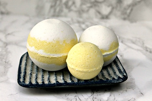 DIY Lemon Swirl Bath Bombs- Commercial bath bombs can be pricey, but homemade bath bombs are really inexpensive! Save money and make your own homemade lemon swirl bath bombs with this tutorial! | DIY beauty products, DIY gift ideas, homemade gift ideas, essential oils, #bathBomb #DIY #ACultivatedNest