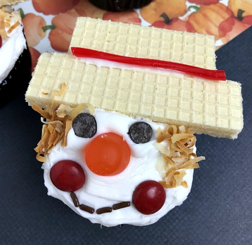 Scarecrow Cupcakes Cute Fall Dessert Recipe- For a fun and easy fall dessert, you have to make these cute scarecrow cupcakes! They'd be a lot of fun to decorate with kids! | recipe, autumn food, #dessert #cupcakes #ACultivatedNest