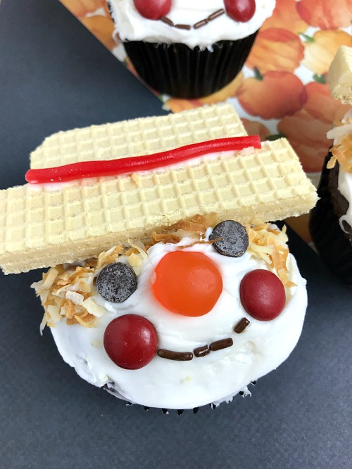 Scarecrow Cupcakes Autumn Dessert- For a fun and easy fall dessert, you have to make these cute scarecrow cupcakes! They'd be a lot of fun to decorate with kids! | recipe, autumn food, #dessert #cupcakes #ACultivatedNest