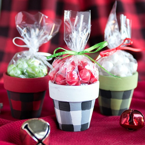 DIY Buffalo Check Terracotta Gift Pots- These DIY buffalo check terracotta gift pots are a fun and creative way to give food gifts or homemade gifts! These would be perfect for Christmas! | handmade gift, homemade gift, craft, how to wrap food gifts, how to give food presents, candy gift containers, #diy #Christmas #ACultivatedNest