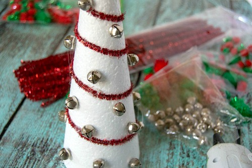 DIY Pom Pom Christmas Tree- Add pretty (and inexpensive) decor to your Christmas table or mantel with this DIY dollar store Christmas tree centerpiece! | Christmas craft, holiday DIY, pom pom Christmas tree, dollar store craft, #Christmas #DIY #ACultivatedNest