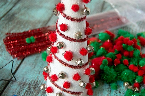Pom Pom Christmas Tree Craft- Add pretty (and inexpensive) decor to your Christmas table or mantel with this DIY dollar store Christmas tree centerpiece! | Christmas craft, holiday DIY, pom pom Christmas tree, dollar store craft, #Christmas #DIY #ACultivatedNest