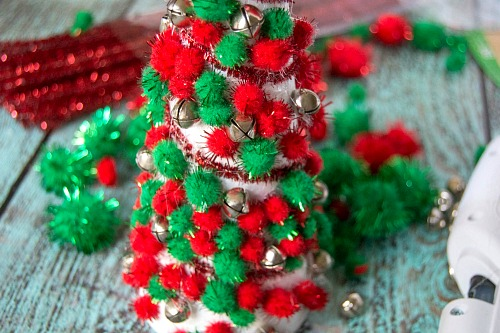 Dollar Store Christmas Decor DIY- Add pretty (and inexpensive) decor to your Christmas table or mantel with this DIY dollar store Christmas tree centerpiece! | Christmas craft, holiday DIY, pom pom Christmas tree, dollar store craft, #Christmas #DIY #ACultivatedNest