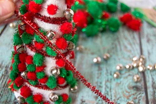 Dollar Store Christmas Decor Craft- Add pretty (and inexpensive) decor to your Christmas table or mantel with this DIY dollar store Christmas tree centerpiece! | Christmas craft, holiday DIY, pom pom Christmas tree, dollar store craft, #Christmas #DIY #ACultivatedNest