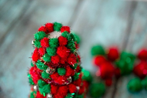 Pom Pom Christmas Tree Centerpiece- Add pretty (and inexpensive) decor to your Christmas table or mantel with this DIY dollar store Christmas tree centerpiece! | Christmas craft, holiday DIY, pom pom Christmas tree, dollar store craft, #Christmas #DIY #ACultivatedNest