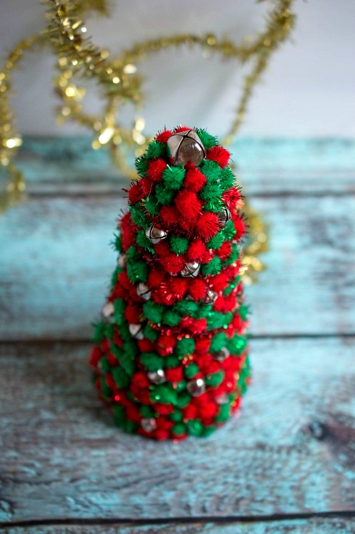 Pom Pom Christmas Tree Decor DIY- Add pretty (and inexpensive) decor to your Christmas table or mantel with this DIY dollar store Christmas tree centerpiece! | Christmas craft, holiday DIY, pom pom Christmas tree, dollar store craft, #Christmas #DIY #ACultivatedNest