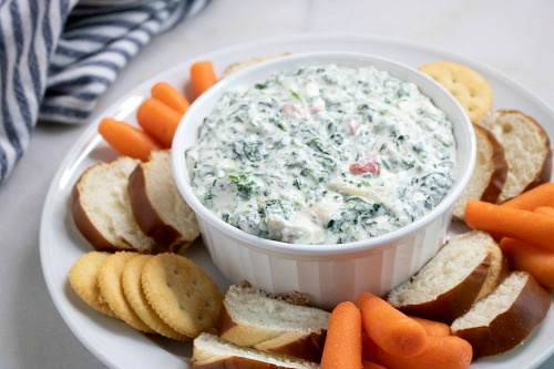 Slow Cooker Spinach Dip- If you want to make spinach dip the easy way, make it in your slow cooker! This slow cooker spinach dip only takes minutes to set up, and is so delicious! | Crock-Pot spinach dip, easy game day recipes, how to make homemade spinach dip, easy food ideas, spinach dip from scratch, #appetizer #slowCooker #ACultivatedNest