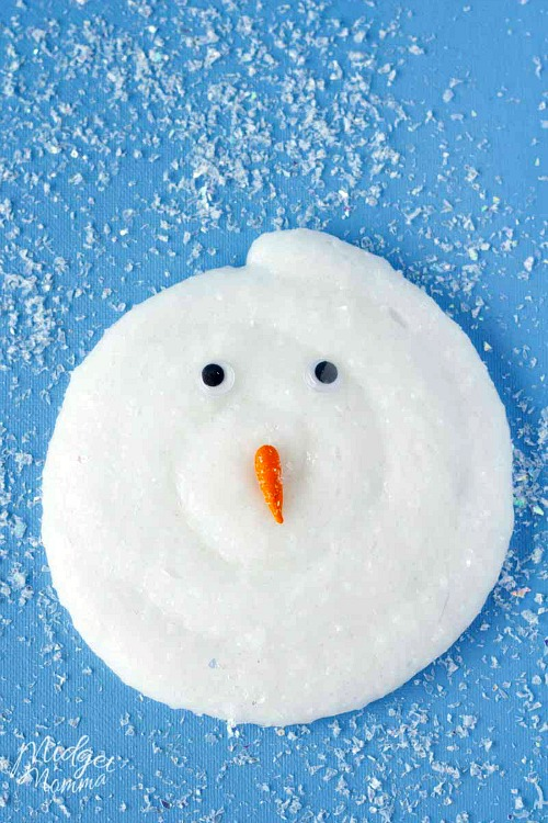 DIY Melted Snowman Slime- These winter kids crafts, free printables, and activities are easy (and inexpensive) ways to keep the kids busy during the winter! A lot of fun learning activities are also included! | kids crafts, kids activities, winter themed kids crafts, snowman kids activities, color by number, snowman slime, homeschooling printables, winter learning activities for kids #freePrintables #kidsActivities #ACultivatedNest