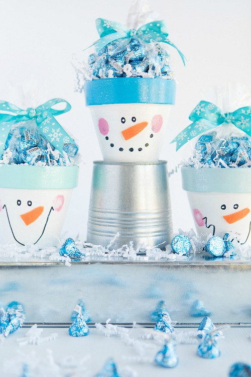 DIY Snowman Candy Pots- These winter kids crafts, free printables, and activities are easy (and inexpensive) ways to keep the kids busy during the winter! A lot of fun learning activities are also included! | kids crafts, kids activities, winter themed kids crafts, snowman kids activities, color by number, snowman slime, homeschooling printables, winter learning activities for kids #freePrintables #kidsActivities #ACultivatedNest