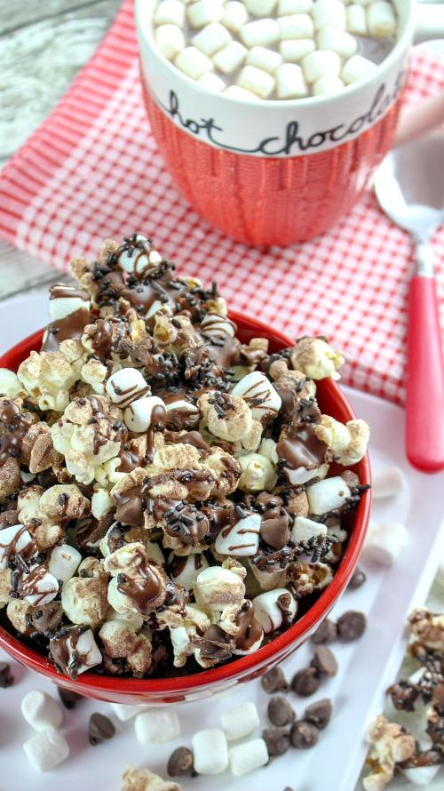 Homemade Hot Chocolate Popcorn Dessert for Winter- This hot chocolate popcorn snack is perfect for winter! It's so delicious, and a very easy dessert popcorn to make for every day, or for family movie night! | easy chocolate snack recipe idea, #chocolate #popcorn #ACultivatedNest