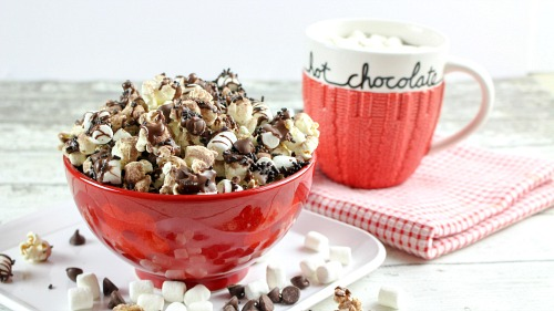 Hot Chocolate Popcorn- This hot chocolate popcorn snack is perfect for winter! It's so delicious, and a very easy dessert popcorn to make for every day, or for family movie night! | easy chocolate snack recipe idea, #chocolate #popcorn #ACultivatedNest