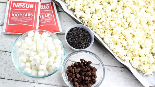 Hot Chocolate Popcorn Recipe- This hot chocolate popcorn snack is perfect for winter! It's so delicious, and a very easy dessert popcorn to make for every day, or for family movie night! | easy chocolate snack recipe idea, #chocolate #popcorn #ACultivatedNest