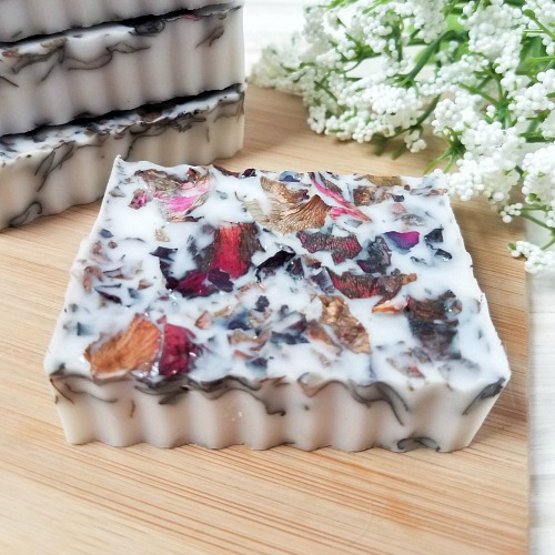 Coconut Rose DIY Soap- If you want a luxurious homemade soap to use or give as a gift, you have to make this coconut rose DIY soap! It uses real rose petals! | DIYs that use essential oils, floral soap, how to make your own soap, melt and pour soap recipes, goat milk soap, #soap #DIY #ACultivatedNest