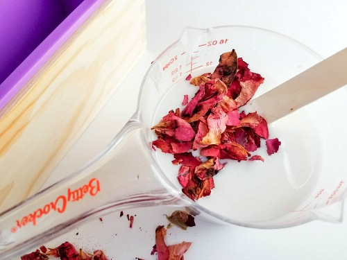 Coconut Rose Melt and Pour Soap Recipe- If you want a luxurious homemade soap to use or give as a gift, you have to make this coconut rose DIY soap! It uses real rose petals! | DIYs that use essential oils, floral soap, how to make your own soap, melt and pour soap recipes, goat milk soap, #soap #DIY #ACultivatedNest