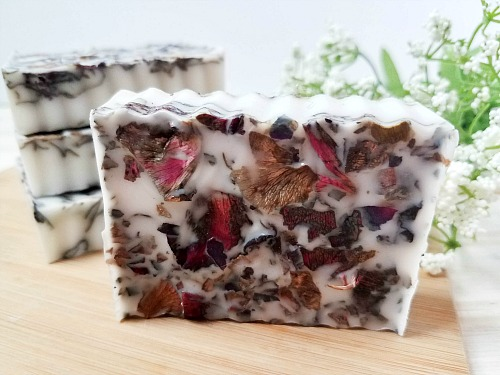 Coconut Rose Easy Homemade Soap Recipe- If you want a luxurious homemade soap to use or give as a gift, you have to make this coconut rose DIY soap! It uses real rose petals! | DIYs that use essential oils, floral soap, how to make your own soap, melt and pour soap recipes, goat milk soap, #soap #DIY #ACultivatedNest