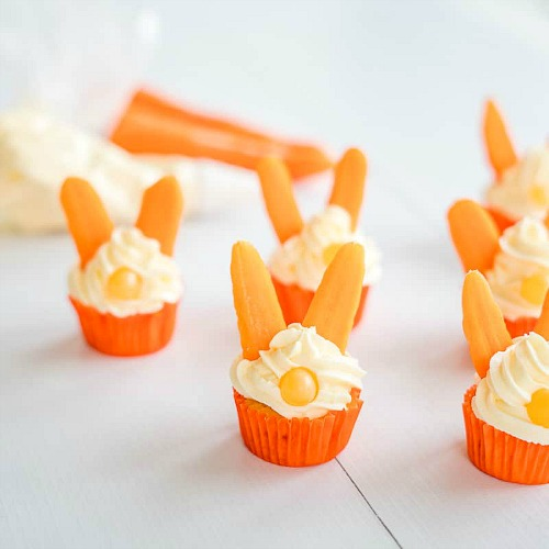 Easter Bunny Carrot Cupcakes Snacktivity- Keep your kids entertained this Easter with these 17 fun and frugal Easter kids activities! They're so fun, and very inexpensive! | spring kids crafts, paper plate crafts, bunny kids crafts, DIY easter eggs, #Easter #kidsActivities #ACultivatedNest