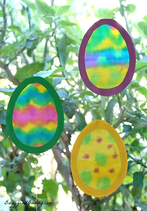 Egg Suncatchers- Keep your kids entertained this Easter with these 17 fun and frugal Easter kids activities! They're so fun, and very inexpensive! | spring kids crafts, paper plate crafts, bunny kids crafts, DIY easter eggs, #Easter #kidsActivities #ACultivatedNest
