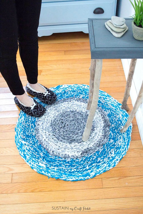 Finger Crochet a Rag Rug from a T-Shirt- Just because a t-shirt's old doesn't mean it's trash! Instead, try one of these awesome ways to upcycle t-shirts! There are a lot of great t-shirt DIYs to try! | repurpose t-shirt, t-shirt restyle, recycle t-shirt, ways to use favorite old shirts, #upcycle #diy #ACultivatedNest