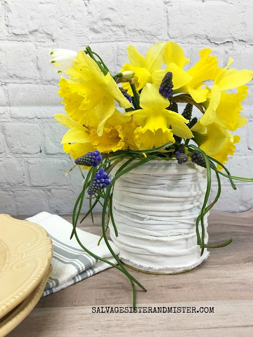 Farmhouse Tin Can Vase T-Shirt Upcycle- Just because a t-shirt's old doesn't mean it's trash! Instead, try one of these awesome ways to upcycle t-shirts! There are a lot of great t-shirt DIYs to try!   repurpose t-shirt, t-shirt restyle, recycle t-shirt, ways to use favorite old shirts, #upcycle #diy #ACultivatedNest