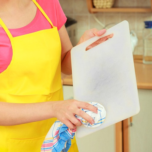 How to Clean and Disinfect Plastic Cutting Boards- Cutting boards can be host to a lot of bacteria, even after washing with soap! Here is how to properly clean and disinfect plastic cutting boards to keep your kitchen safe and germ-free! | how to clean cutting boards, ways to disinfect cutting boards, kitchen cleaning tips, #cleaningTips #cleaning #ACultivatedNest