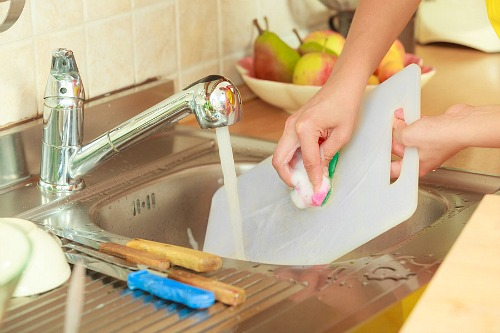 4 Ways to Clean and Disinfect Plastic Cutting Boards- Cutting boards can be host to a lot of bacteria, even after washing with soap! Here is how to properly clean and disinfect plastic cutting boards to keep your kitchen safe and germ-free! | how to clean cutting boards, ways to disinfect cutting boards, kitchen cleaning tips, #cleaningTips #cleaning #ACultivatedNest