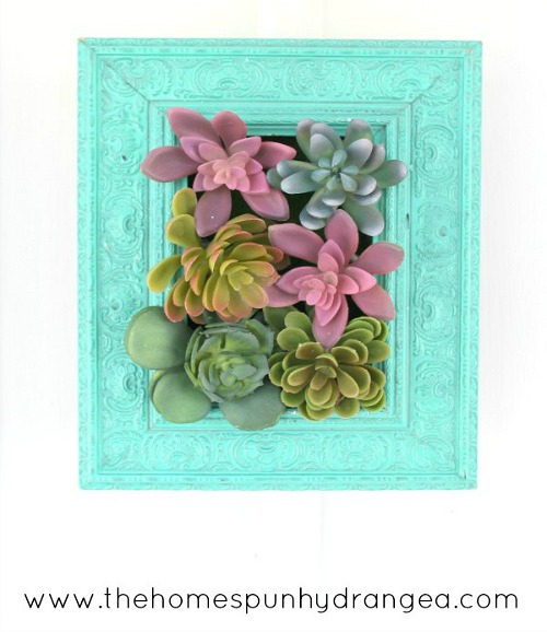 Vertical Succulent Garden- An inexpensive and easy way to make pretty decor is with dollar store materials! Check out all of this pretty home decor made with dollar store frames! | dollar store decor DIY projects, dollar store crafts, upcycle old frames, #dollarStore #dollarTree #DIY #decor #AcultivatedNest