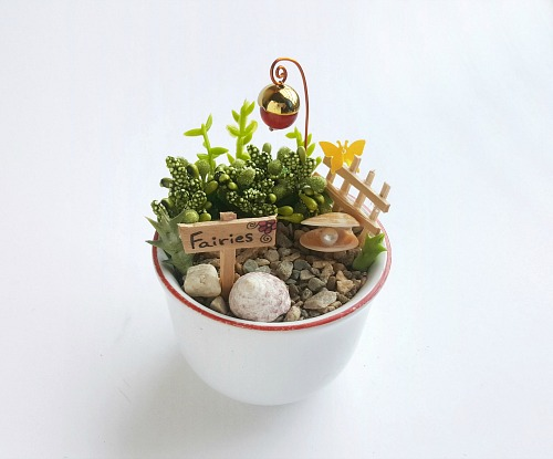 Mini Teacup Garden DIY- If you want a cute and creative decor piece for your home, you have to make this DIY teacup fairy garden! It's so easy to make, and so pretty when finished! | DIY fairy garden accessories, indoor gardening, container garden, DIY fairy garden props, #fairyGarden #teacupGarden #DIY #ACultivatedNest