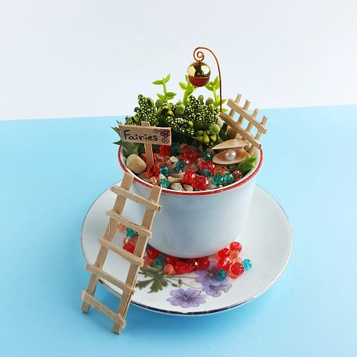 Mini Fairy Garden Craft- If you want a cute and creative decor piece for your home, you have to make this DIY teacup fairy garden! It's so easy to make, and so pretty when finished! | DIY fairy garden accessories, indoor gardening, container garden, DIY fairy garden props, #fairyGarden #teacupGarden #DIY #ACultivatedNest