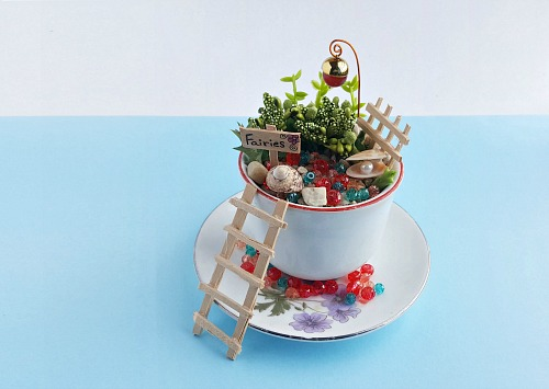 DIY Teacup Fairy Garden- If you want a cute and creative decor piece for your home, you have to make this DIY teacup fairy garden! It's so easy to make, and so pretty when finished! | DIY fairy garden accessories, indoor gardening, container garden, DIY fairy garden props, #fairyGarden #teacupGarden #DIY #ACultivatedNest