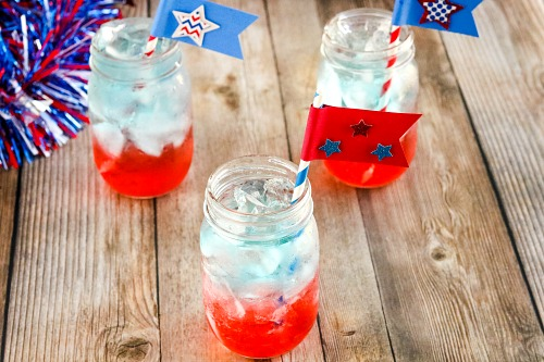 Red, White, and Blue Layered Drink + Straw Flags Craft- For a fun (and tasty) drink to serve at your next Memorial Day or Fourth of July party, make this red, white, and blue layered drink + DIY straw flags! | patriotic drink recipe, homemade drink, #drinkRecipe #FourthOfJuly #MemorialDay #ACultivatedNest