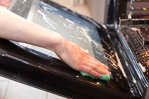 Cleaning Your Oven with a Homemade Cleaner- Tired of your oven being a mess? This huge oven cleaning guide has all the easiest ways to clean your oven, inside and out! | kitchen cleaning tips, clean oven glass, clean oven racks, #homemadeCleaningProducts #DIYCleaner #cleaningTips #ACultivatedNest