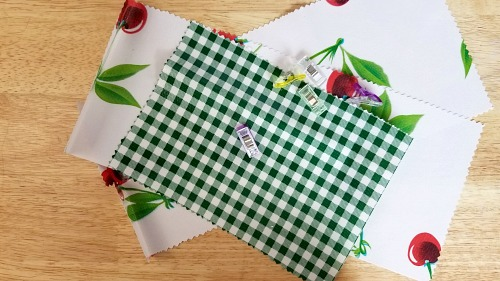 DIY Reusable Lunch Bags Made with Oilcloth- If you want to do something good for the environment and your budget, you should make your own DIY reusable lunch bags with my easy tutorial! They're eco-friendly, frugal, and easy to customize! | reduce paper waste, alternatives to paper lunch bags, how to sew a lunch bag, #DIYProject #ecoFriendly #tutorial #sewingProject #ACultivatedNest
