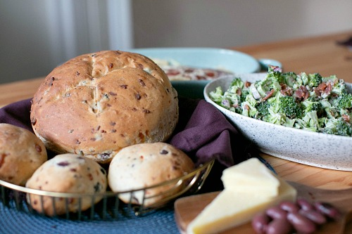 Gourmet Parmesan Olive Homemade Bread- There's nothing better than fresh baked bread made from scratch! This homemade olive Parmesan bread is delicious and a perfect pair for so many dishes! | homemade bread recipe, how to make bread without a bread machine, bread rolls recipe, gourmet bread recipe, #homemade #baking #bread #recipe #ACultivatedNest