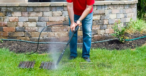 Pressure Wash Your Grill Racks- It doesn't have to take ages to clean your gas or charcoal grill, if you know these tips! Here are all the best tips and tricks for how to clean your grill the easy way! | clean grill grates, grill cleaning hacks, clean charcoal grill, clean gas grill, clean grill at the end of summer, #grilling #cleaningTips #cleaning #ACultivatedNest